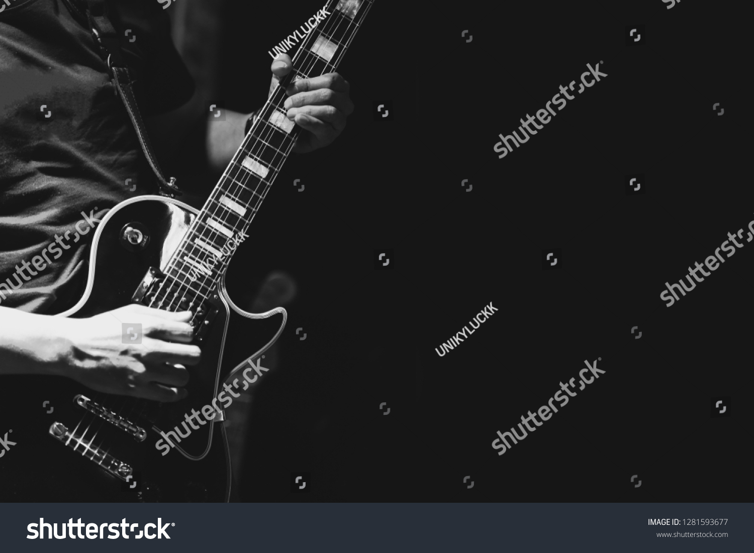Guitarist on stage for background, soft and blur concept. Close up hand playing guitar. young musician playing guitar, live music background.Band performs on stage, rock music concert. #1281593677