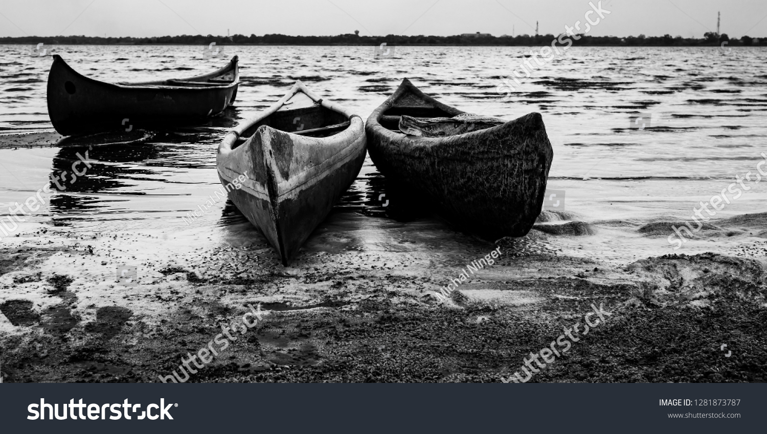 stock-photo-several-canoes-set-on-the-sh