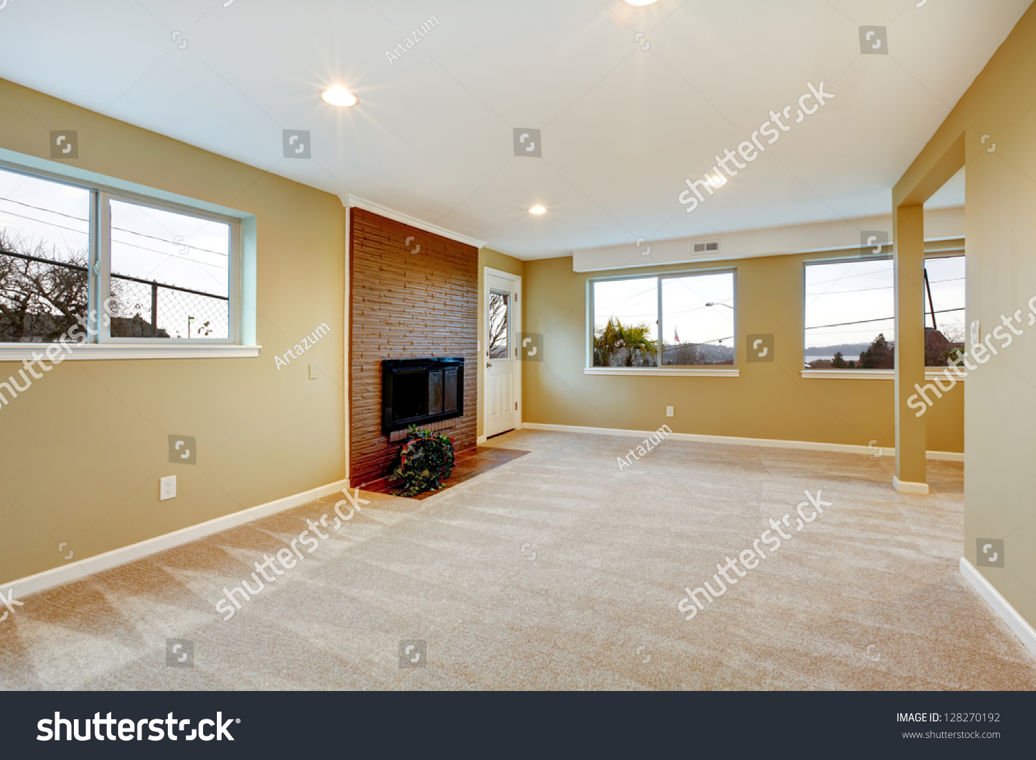 New Living Room With Fireplace Beige Carpet And Many Windows