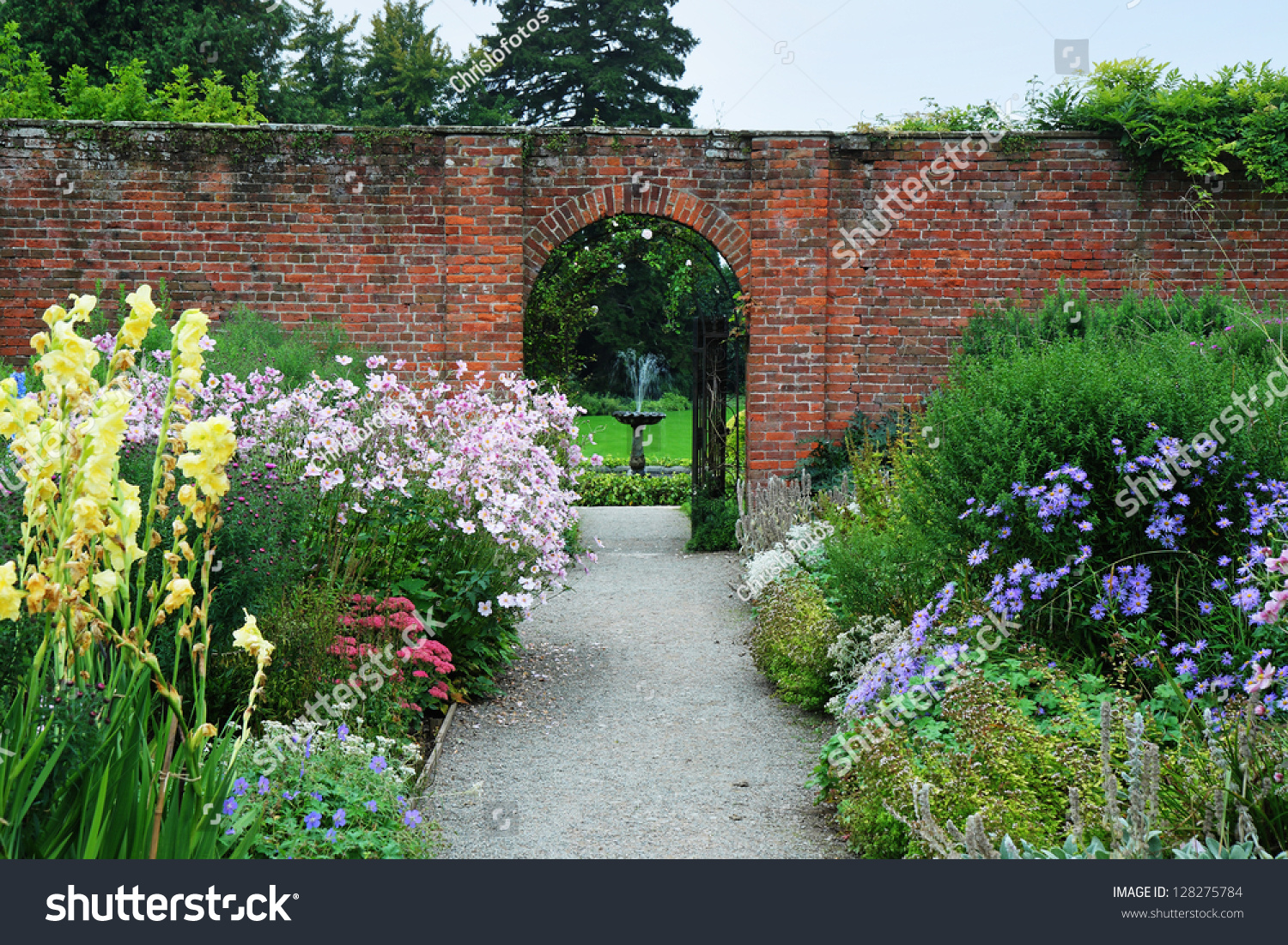 English landscape garden colorful borders summer stock photo an english landscape garden with colorful borders of summer flowers and arch through a wall workwithnaturefo