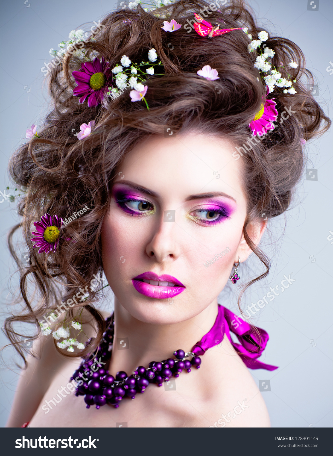 Young beautiful woman flowers her hair stock photo 128301149 young beautiful woman with flowers in her hair and bright artistic makeup dhlflorist Gallery