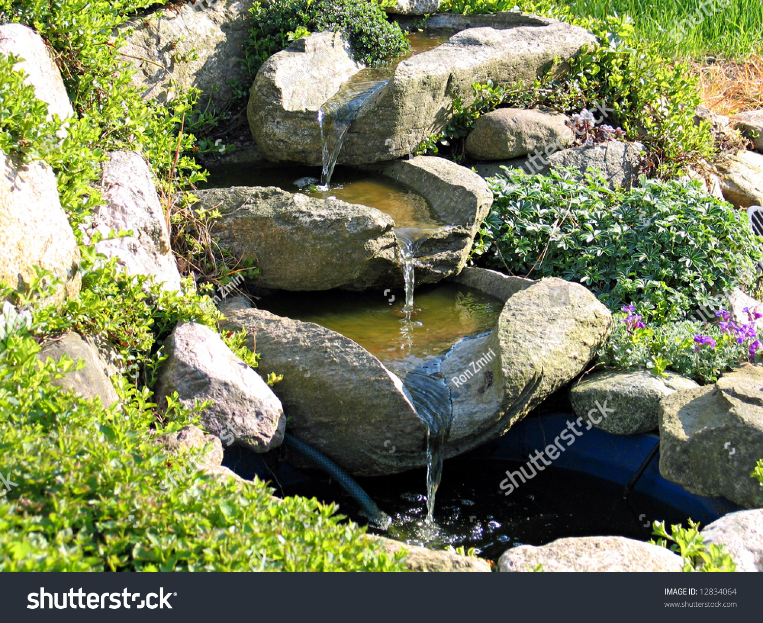 Beautiful decorative home garden stone waterfall stock for Garden pond stones