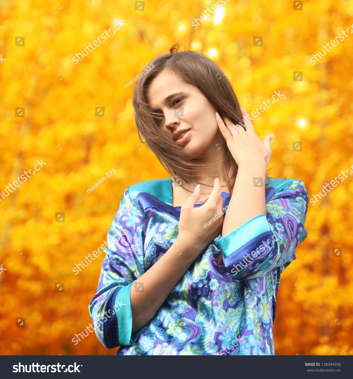 Happy Beautiful Woman Enjoying At Beach Stock Photo: Happy Beautiful Hispanic Girl Enjoy The Autumn . Portrait