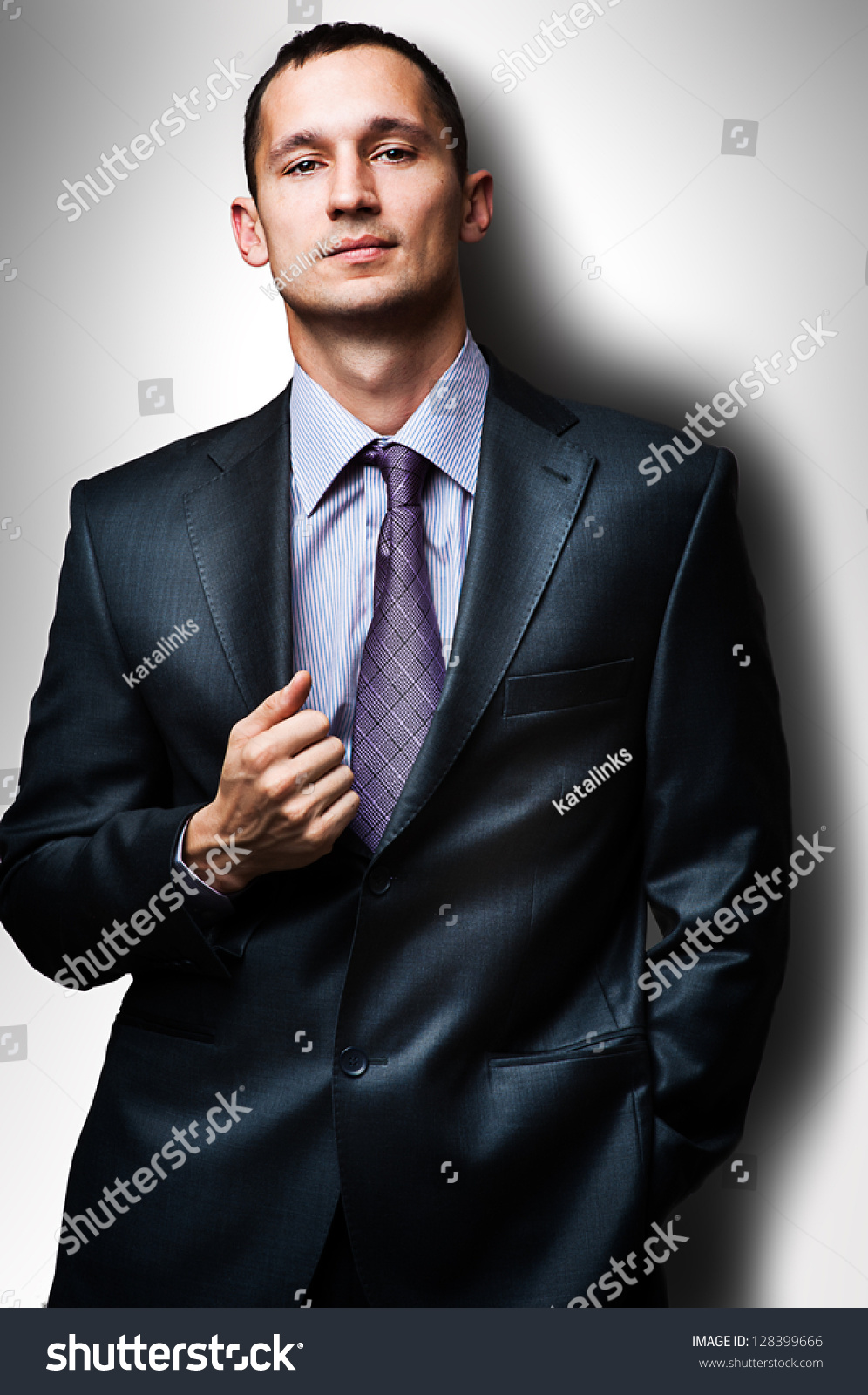 Young Handsome Man Wearing Suit And Tie Stock Photo ...