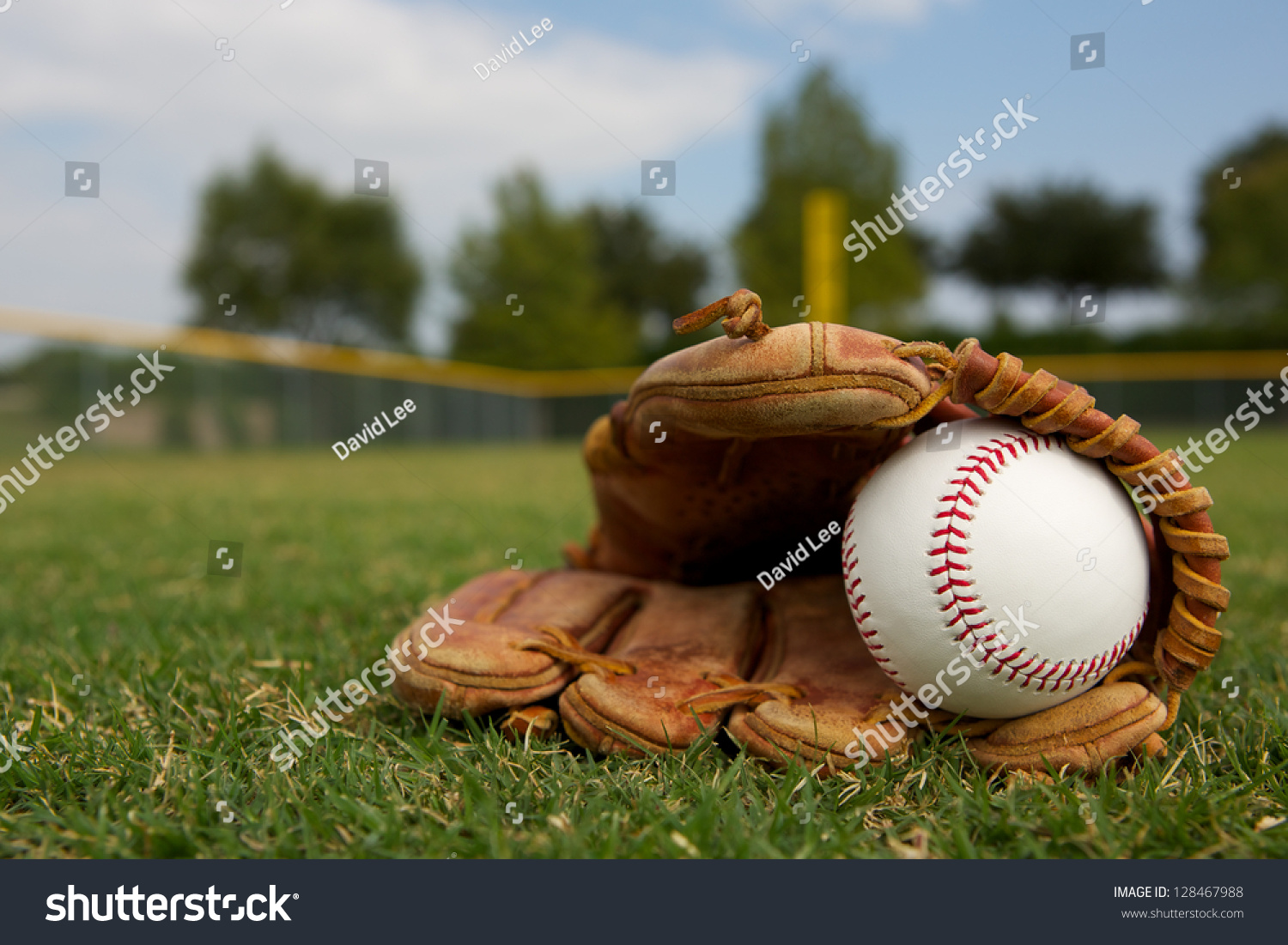 New Baseball in a Glove in the Outfield #128467988