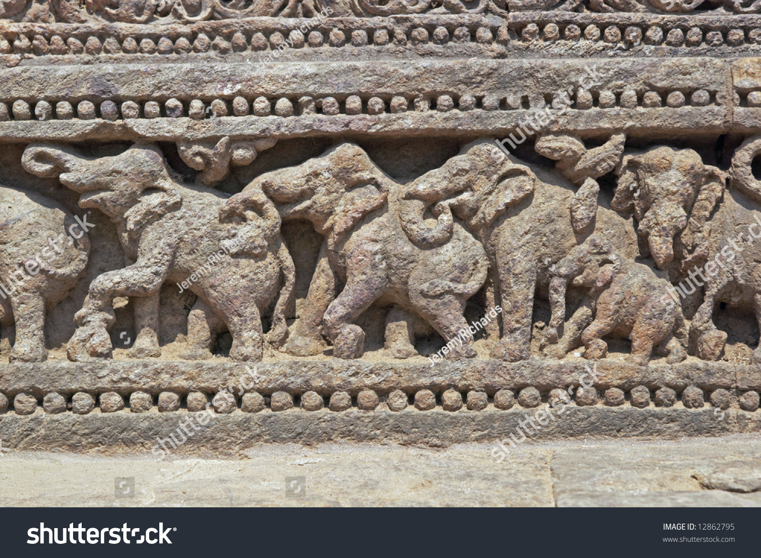 Relief carving elephants around base ancient stock photo
