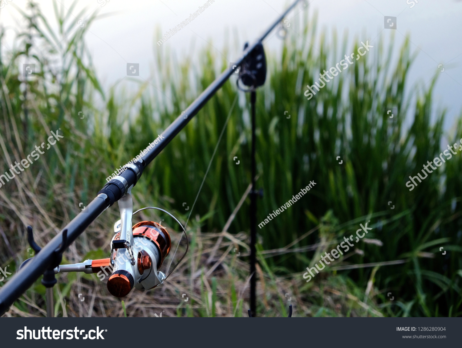 Fishing rod by a river in the summer #1286280904