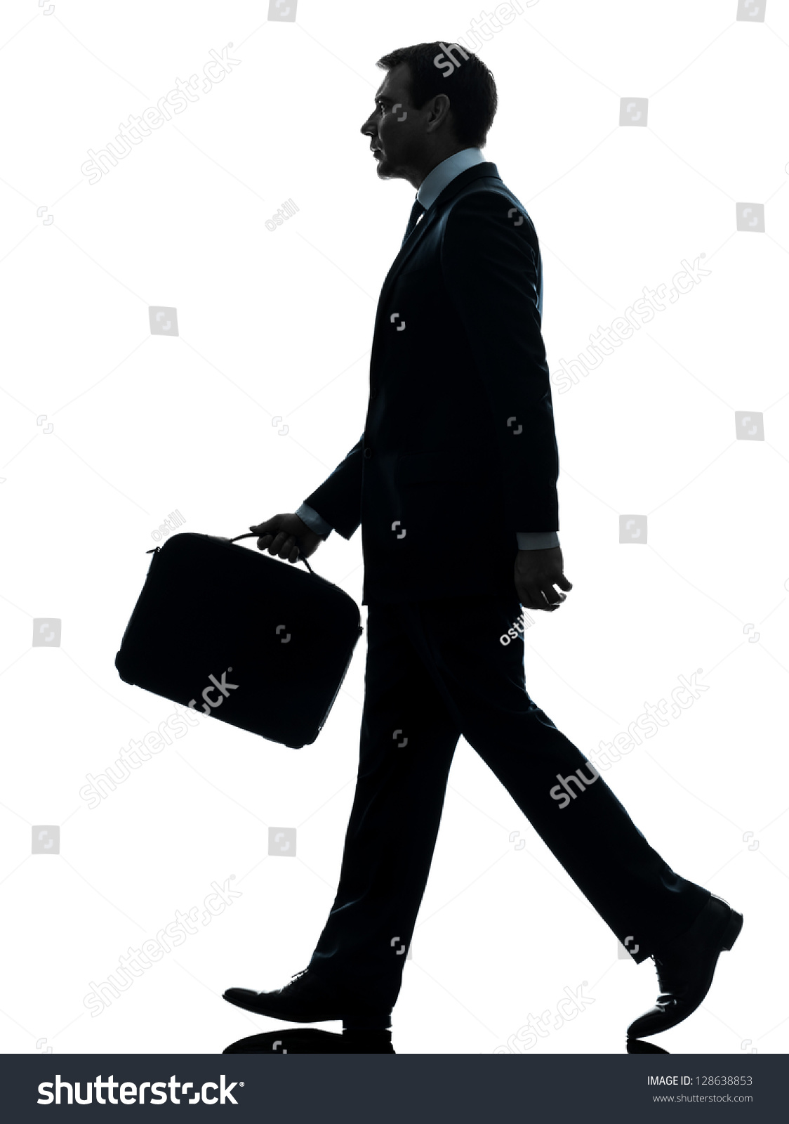 One Caucasian Businessman Walking Side View In Silhouette ...