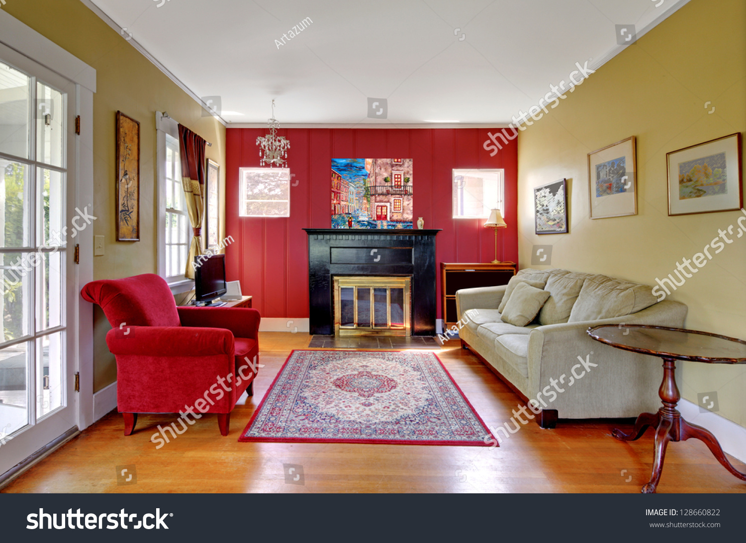 Living Room With Red And Yellow Walls And Fireplace In Old
