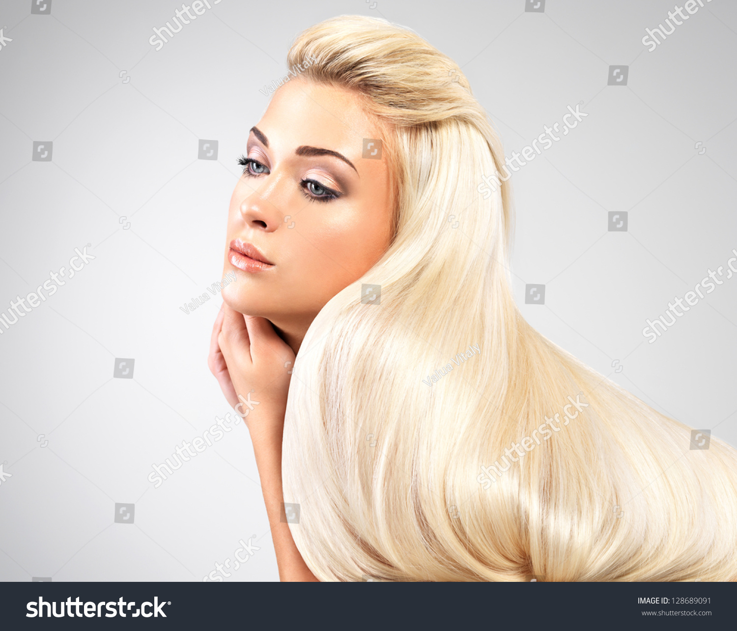 Beautiful Woman With Long Straight Blond Hair. Fashion
