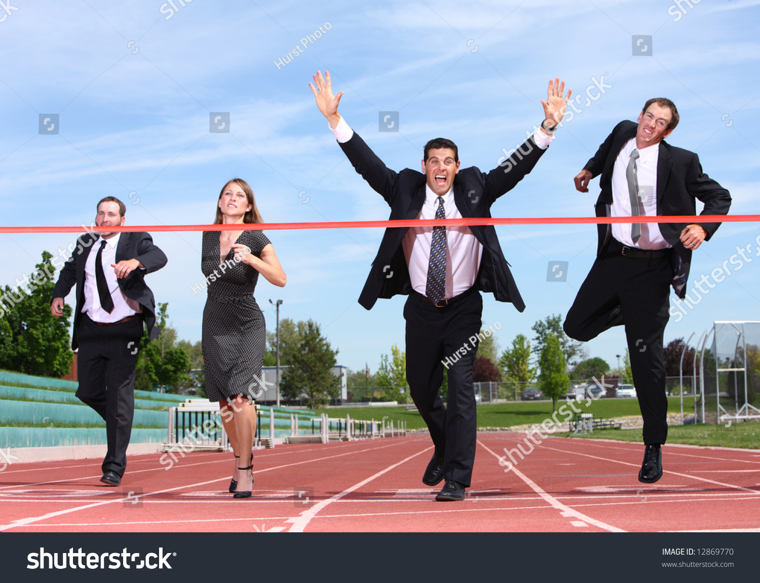 businesspeople crossing finish line stock photo edit now 12869770