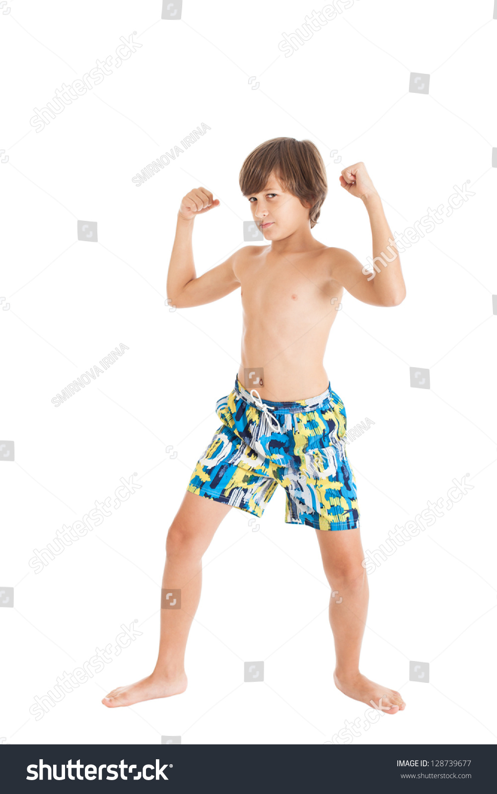 teenboy naked Cute European teen boy in swimming shorts with a naked torso shows biceps.  Studio shot
