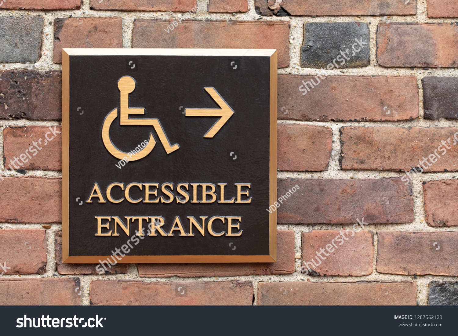 Close On Bronze Wheelchair Handicapped Accessible Stock