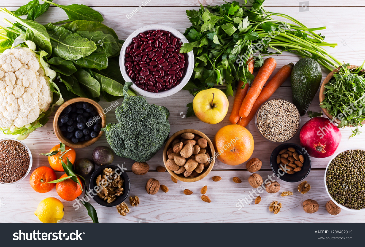 Healthy food clean eating : fruit, vegetable, seeds, superfood, cereals, leaf vegetable on black wood background with copy space, top view. #1288402915