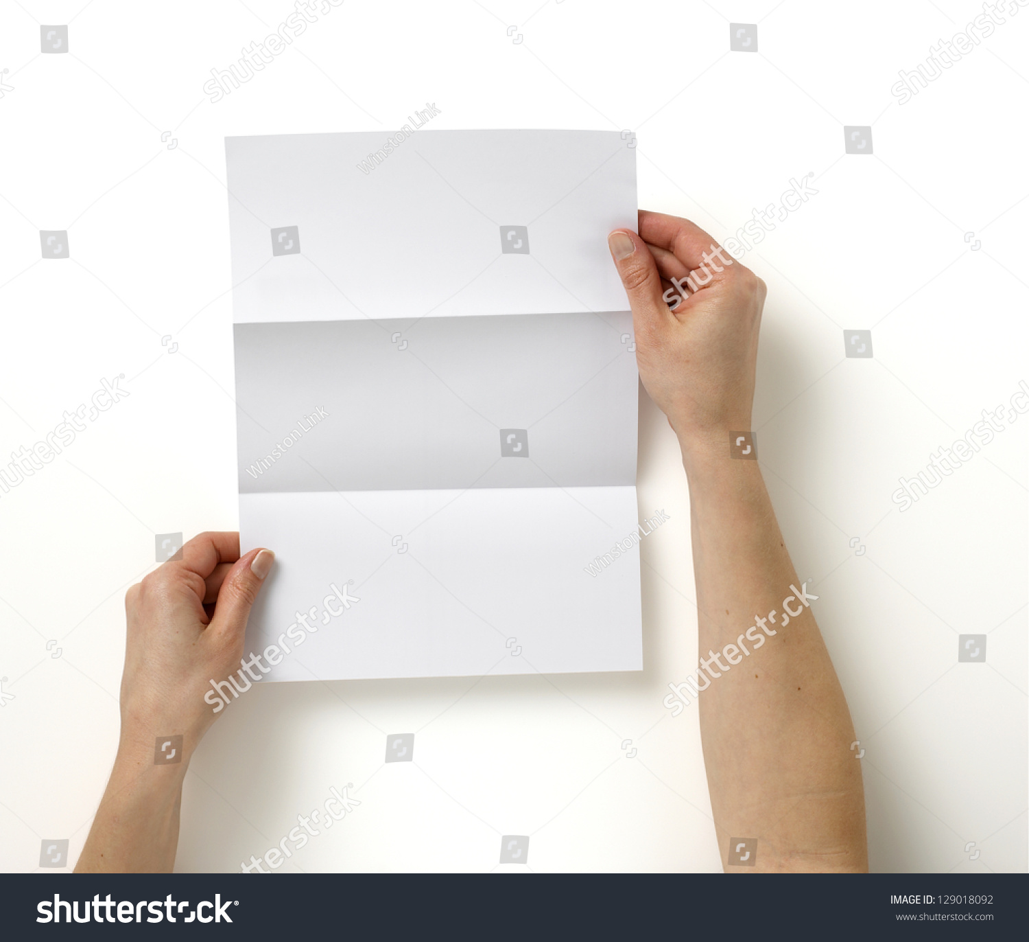 Pair Hands Holding Folded Blank A4 Stock Photo 129018092 ...