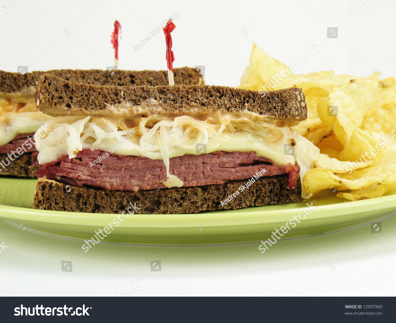 Reuben Sandwiches On Pumpernickel Rye Bread With Potato Chips Stock ...