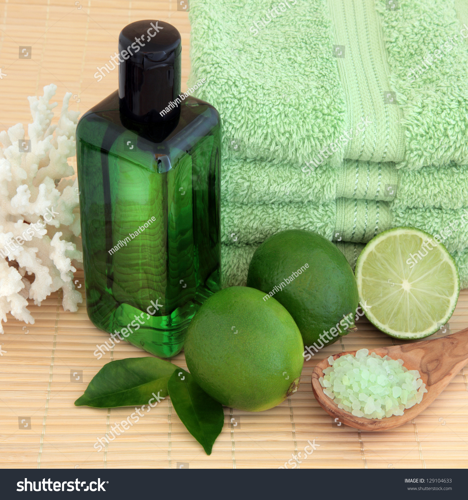 Lime fruit with spa accessories of green towels bubble for Sea green bathroom accessories
