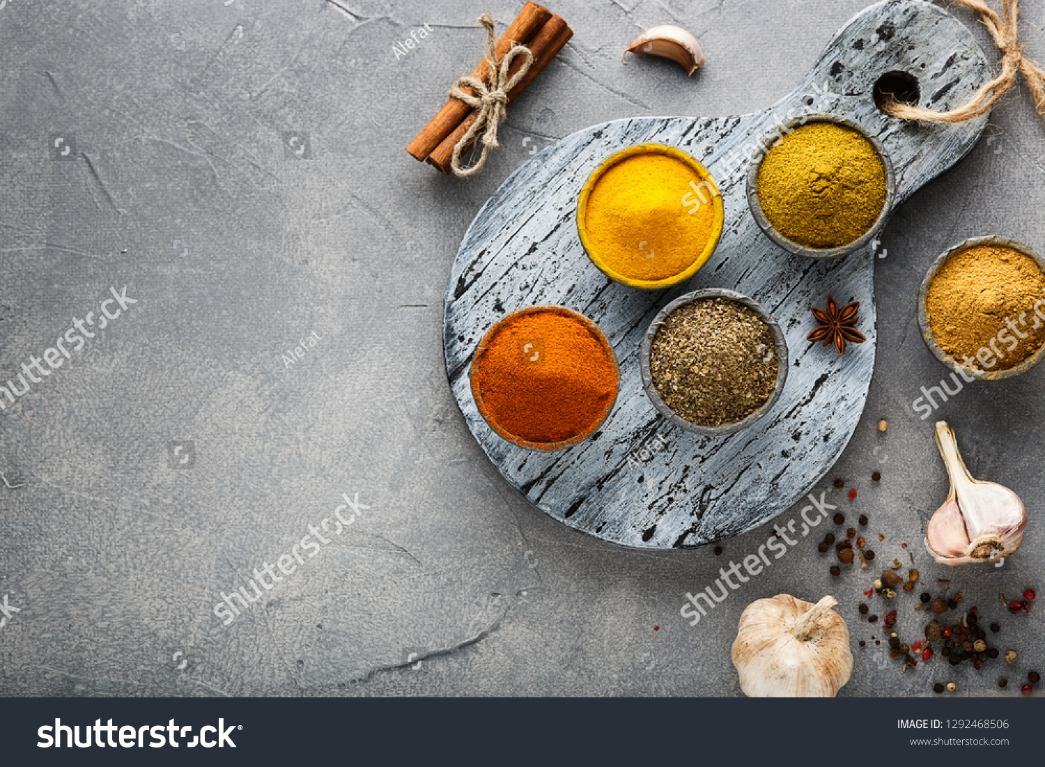 Various colorful spices on wooden table, top view #1292468506