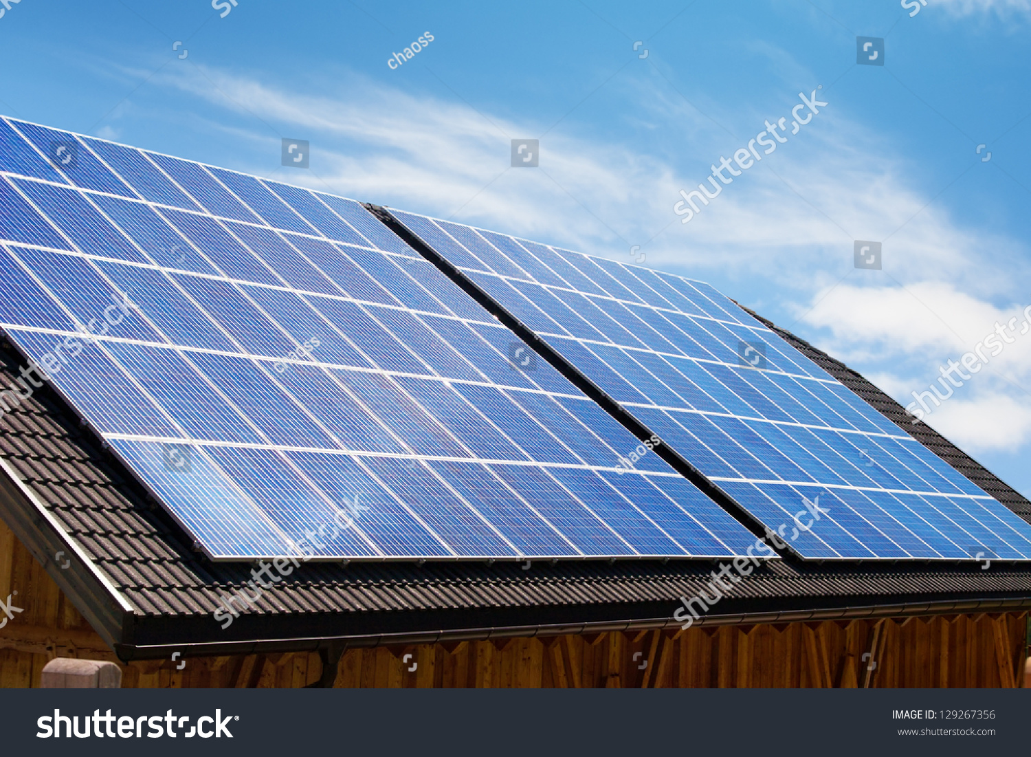 Modern Solar Panels On House Roof In Europe Stock Photo