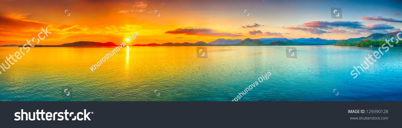 Sunrise over the sea.  Panorama #129390128