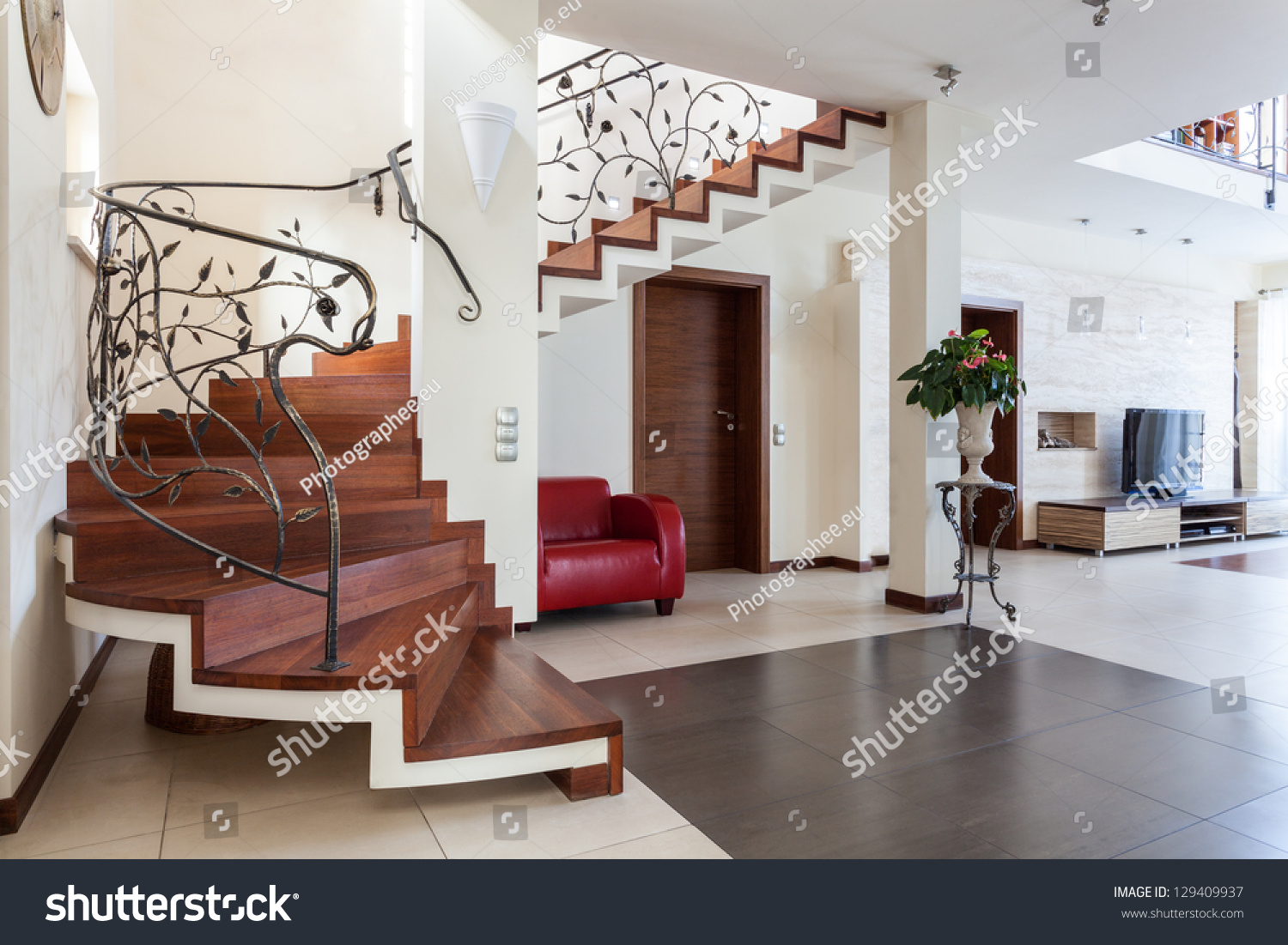 Classy House Living Room Interior With Classic Staircase Stock Photo