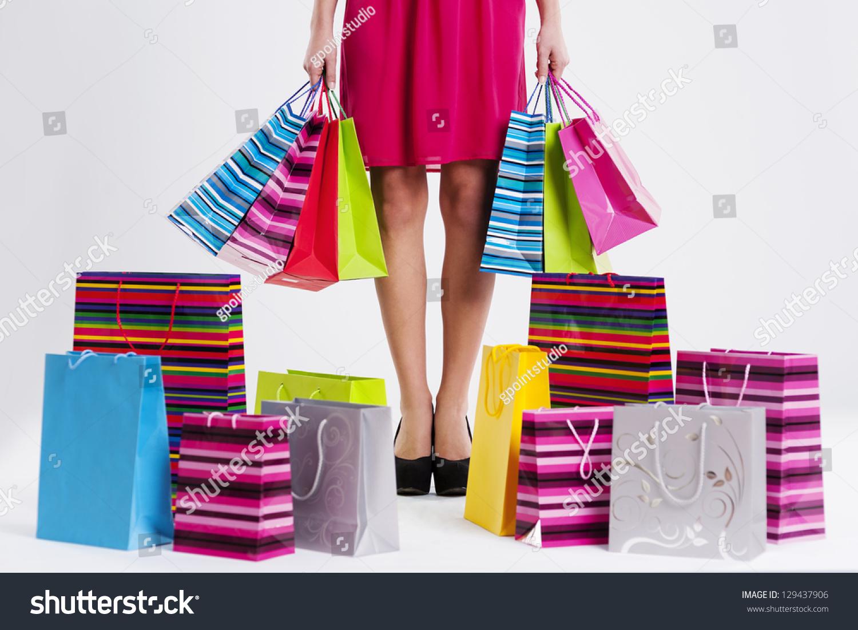 woman full shopping bags stock photo 129437906 shutterstock