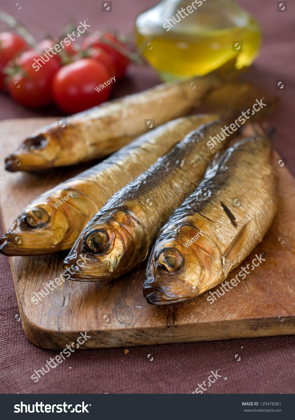 Smoked fish herring or sardine on board selective focus for Smoked herring fish