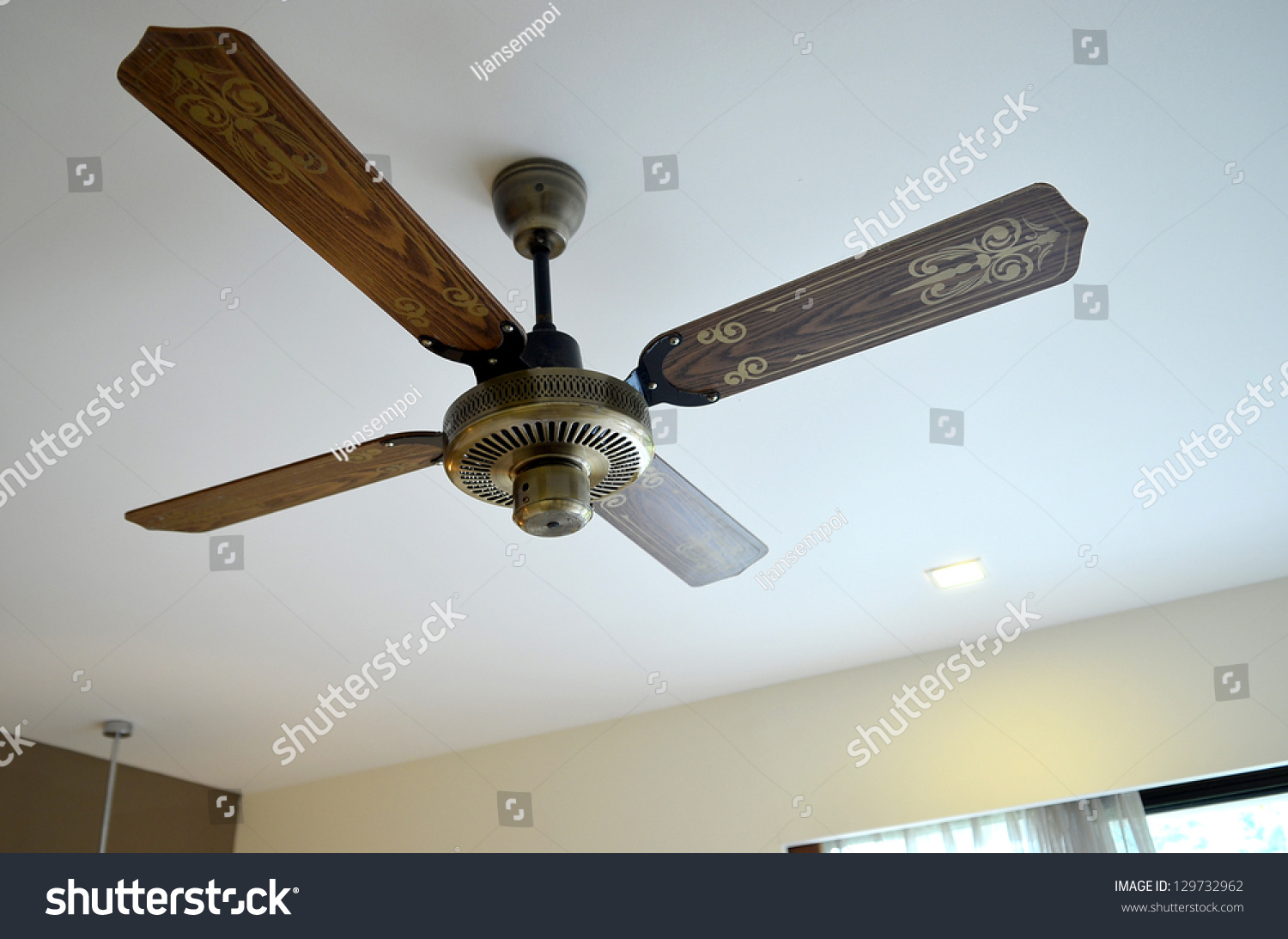 picture of wooden ceiling fan inside the living room stock photo 129732962 shutterstock. Black Bedroom Furniture Sets. Home Design Ideas
