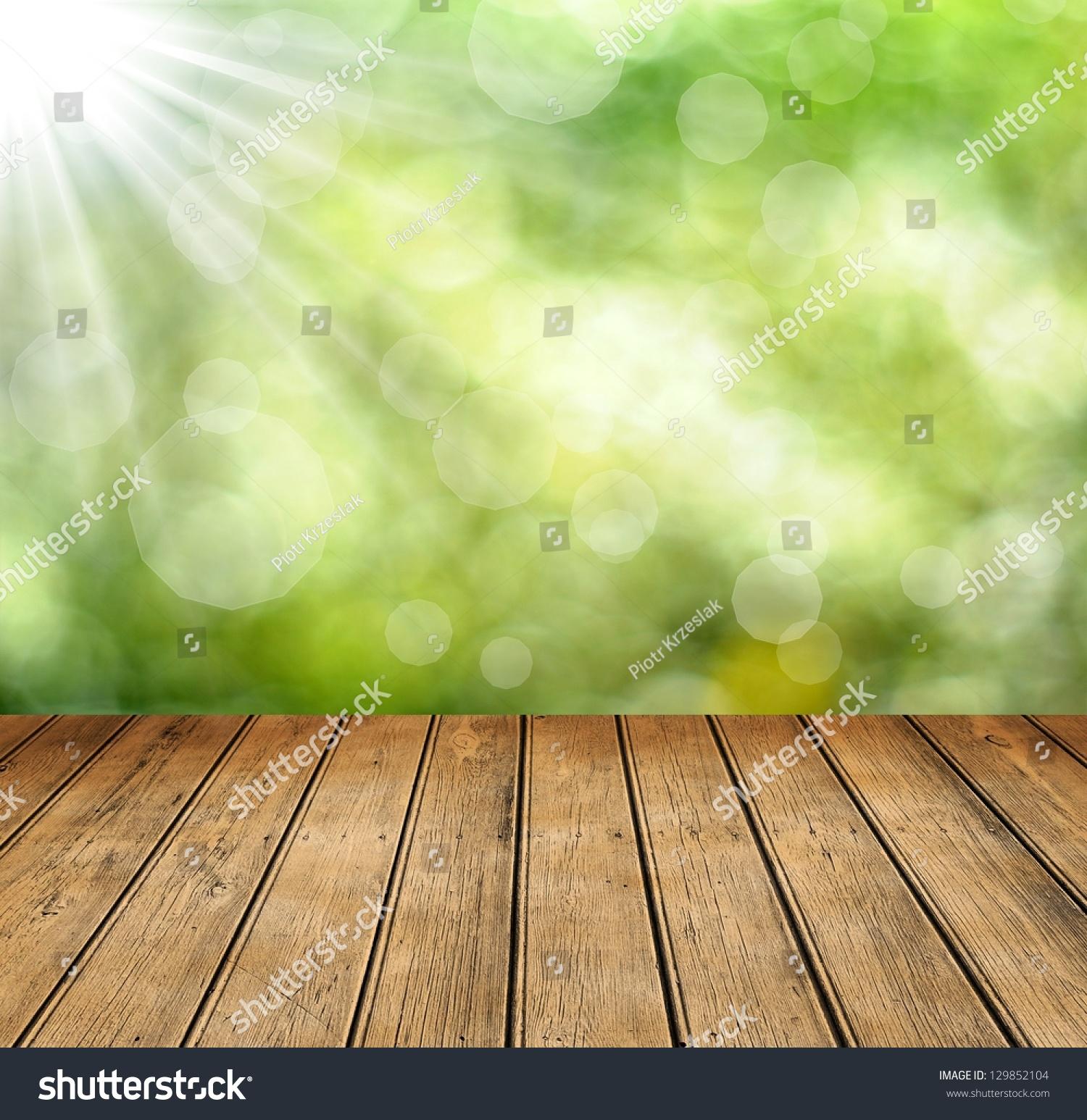 fresh spring green bokeh background wooden stock photo 129852104