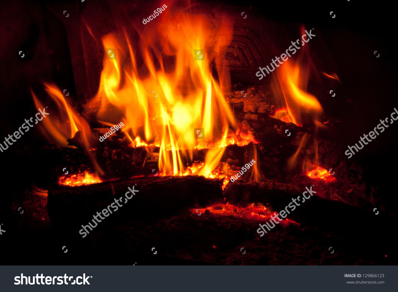 wood on fire fireplace stock photo 129866123 shutterstock