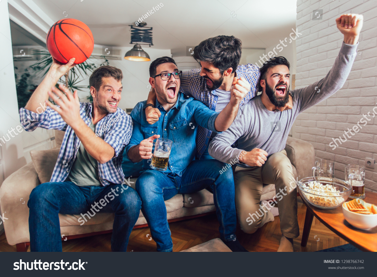 Happy Friends Basketball Fans Watching Basketball Stock Photo Edit Now 1298766742