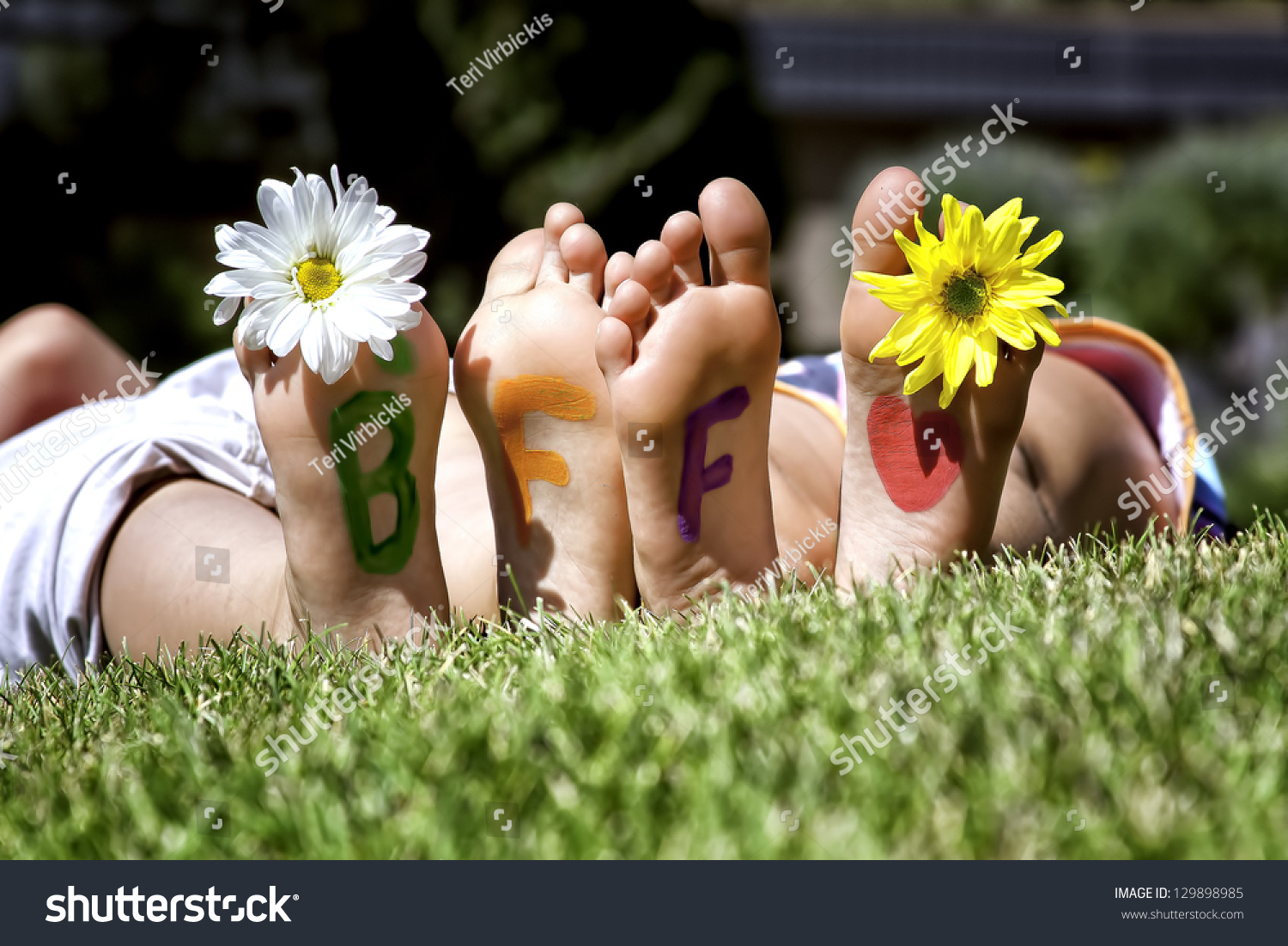 young girls laying grass daisies their stock photo (royalty free