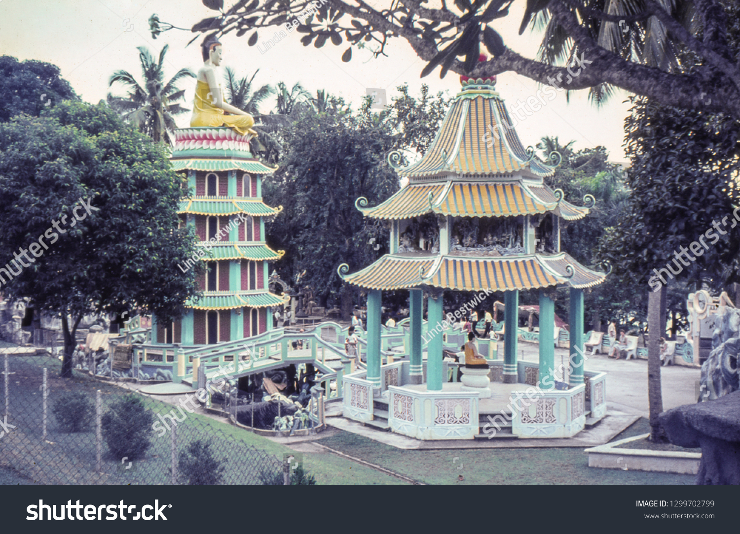 Haw Par Villa, Singapore - Circa, 1964: The pavilion and pagoda at the Tiger Balm Garden. The public gardens were opened in 1937 to promote Tiger Balm products. Vintage photo from a 35mm slide.