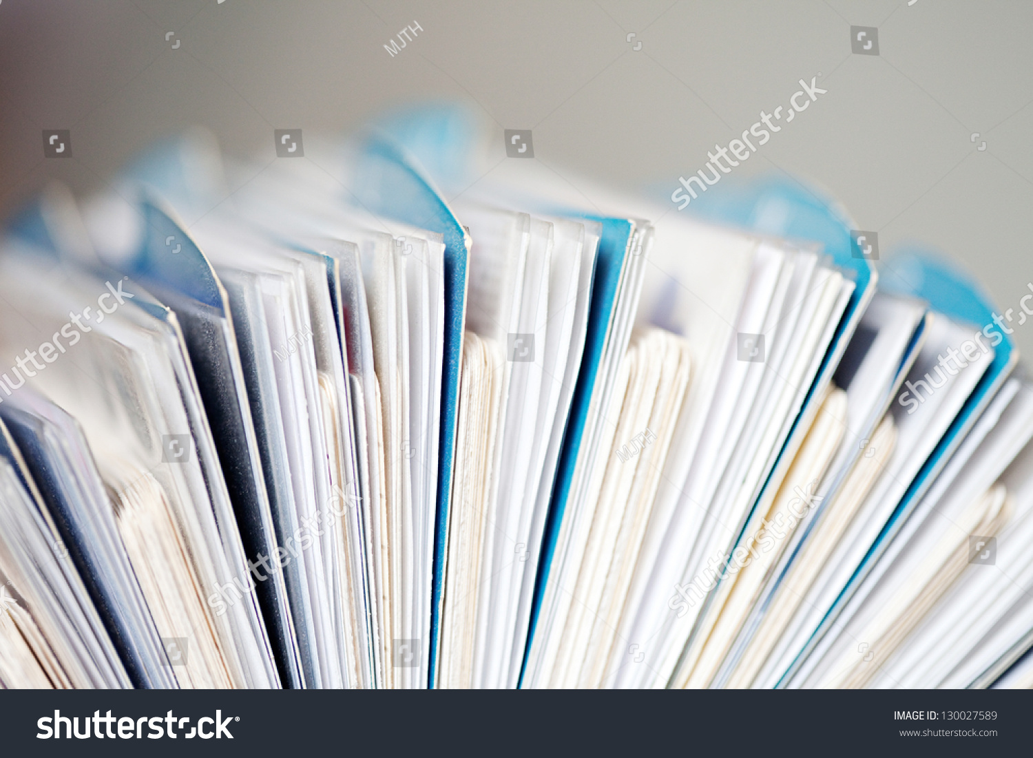 Side close detail view business card stock photo royalty free side close up detail view of a business card holder full of business cards with paper colourmoves