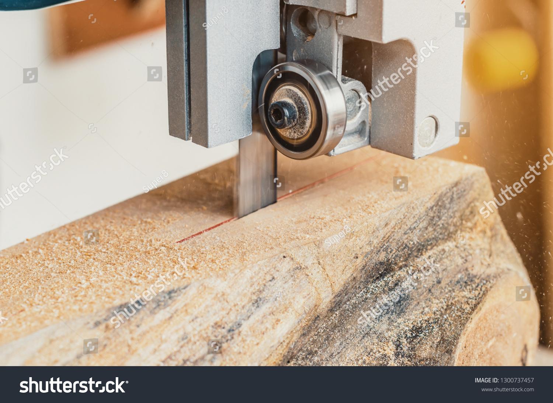 band saw machine cuts log on stock photo (edit now