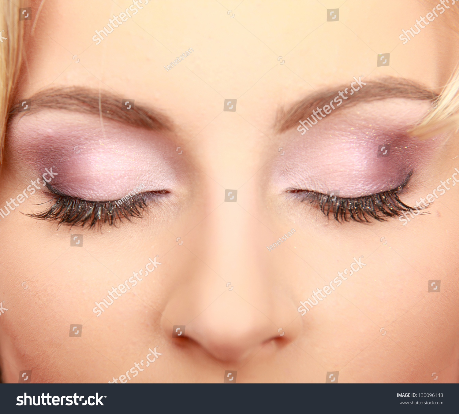 Close-Up Of Relaxed Young Woman With Closed Eyes. Stock