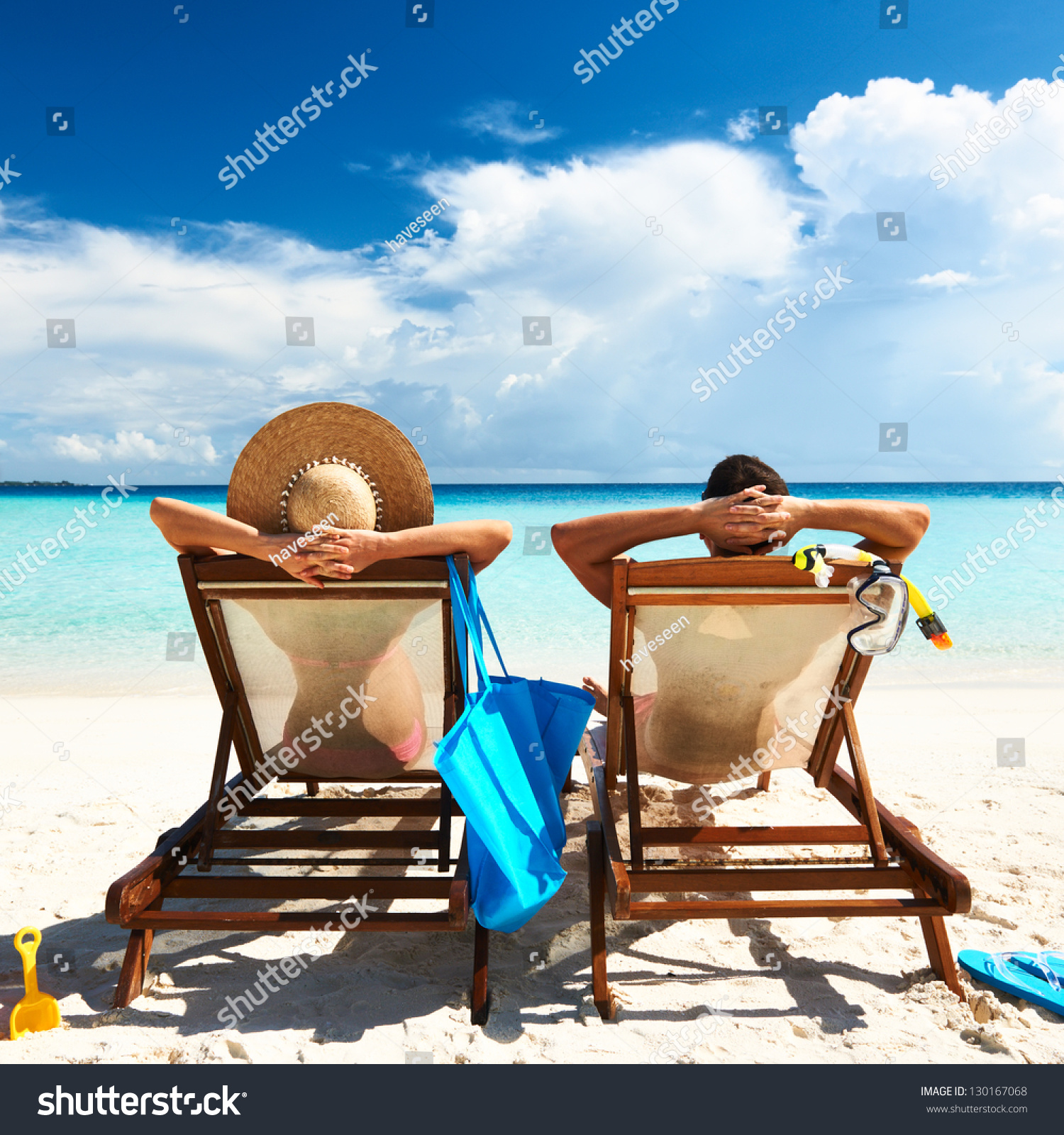 Couple on a tropical beach at Maldives #130167068