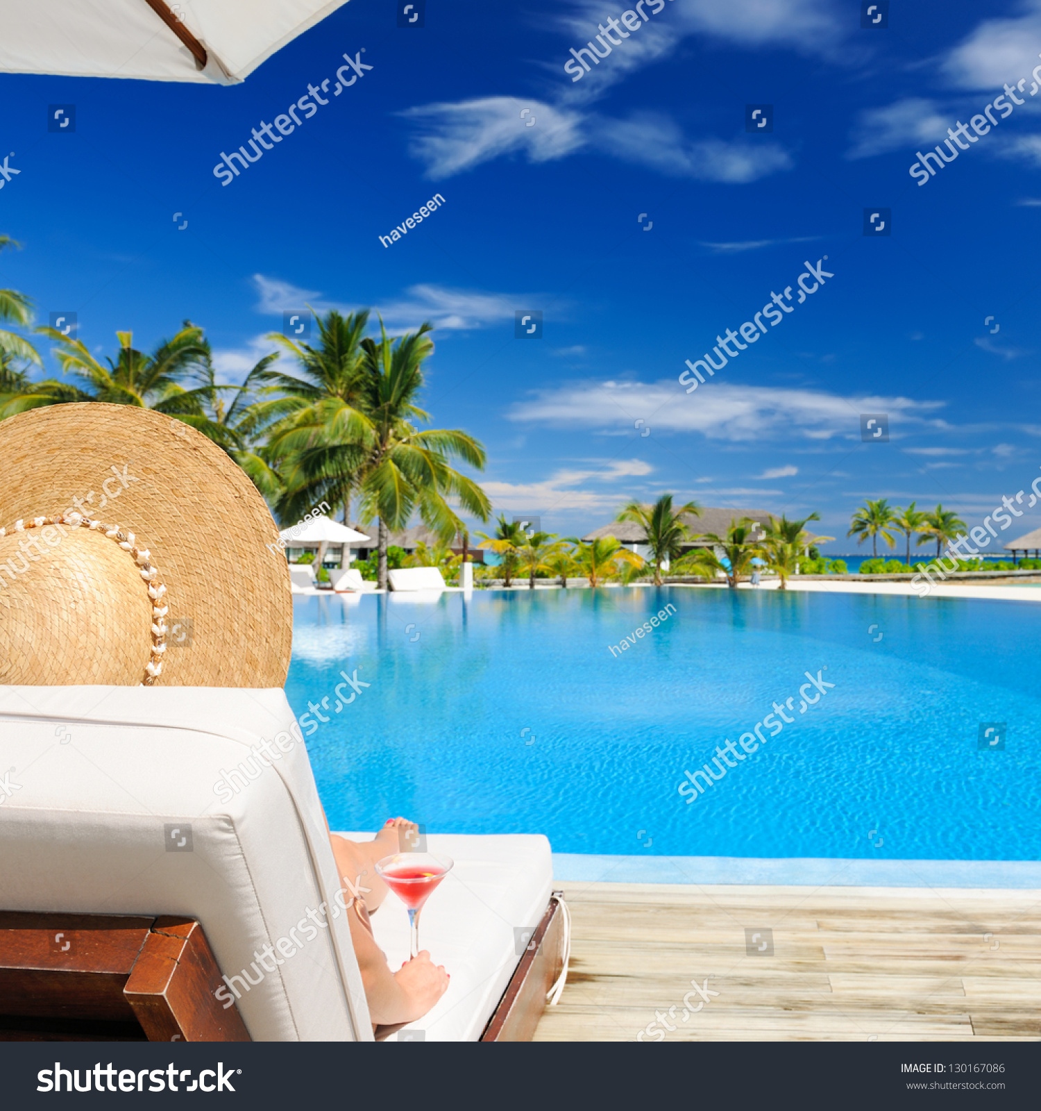 Woman Hat Relaxing Poolside Cosmopolitan Cocktail Stock