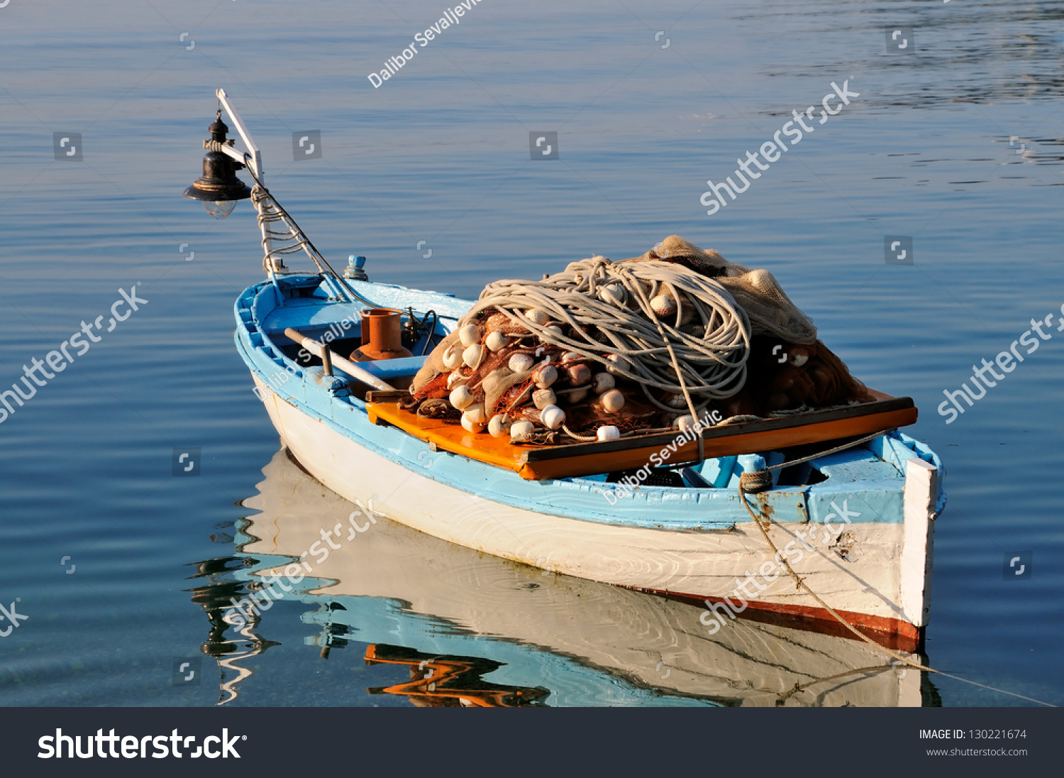 Small fishing boat with fishing net and equipment stock for Small fishing net