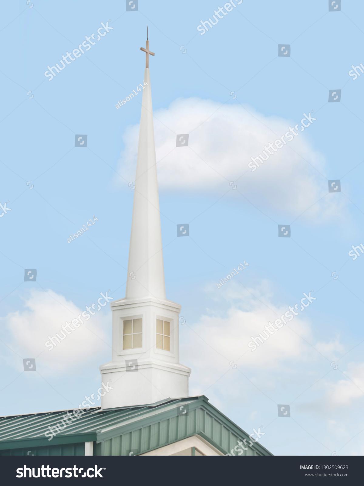stock-photo-church-steeple-against-a-blu