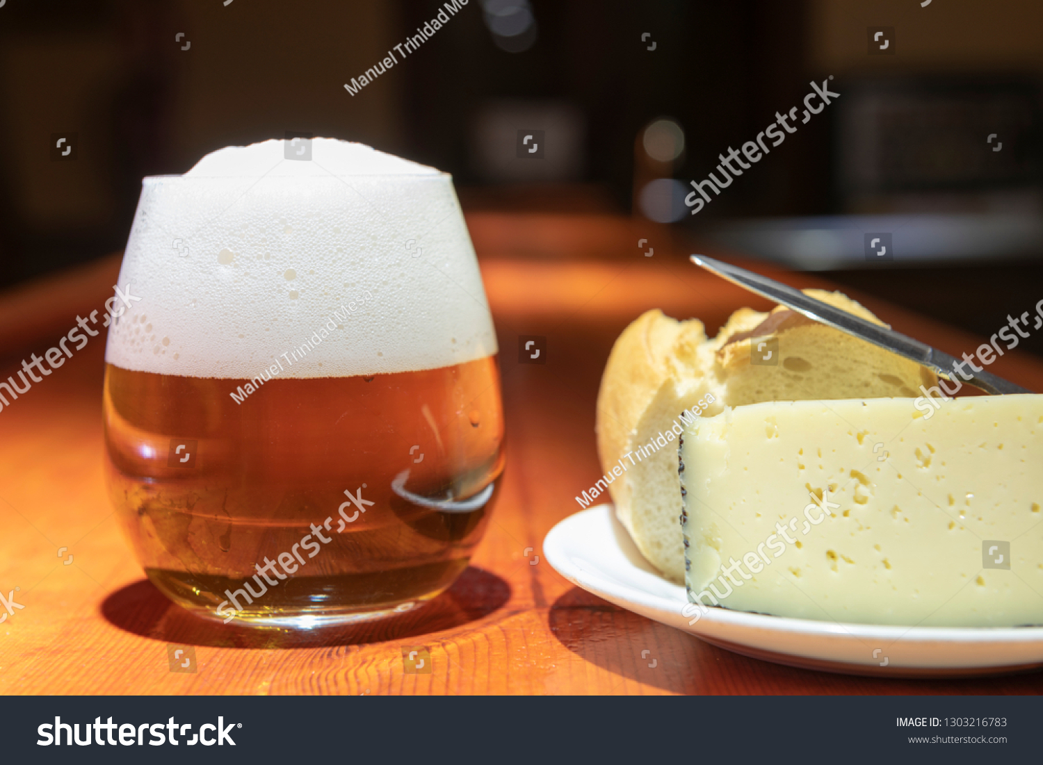 Cheese appetizer and beer