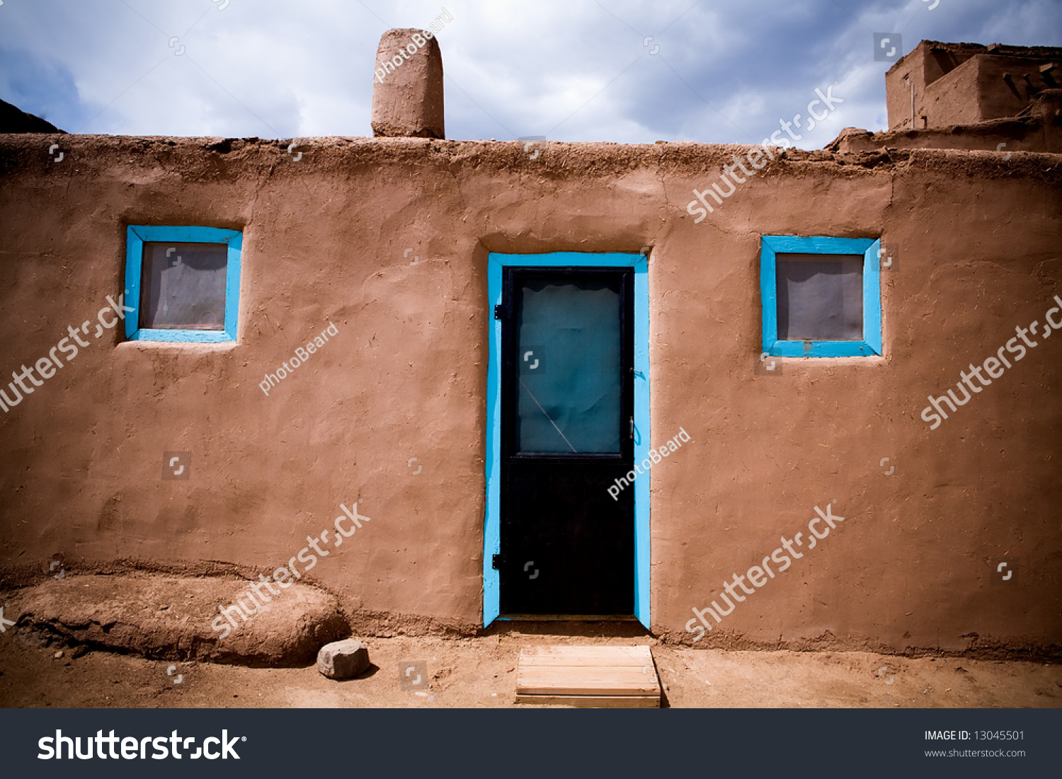 door windows adobe building taos pueblo stock photo