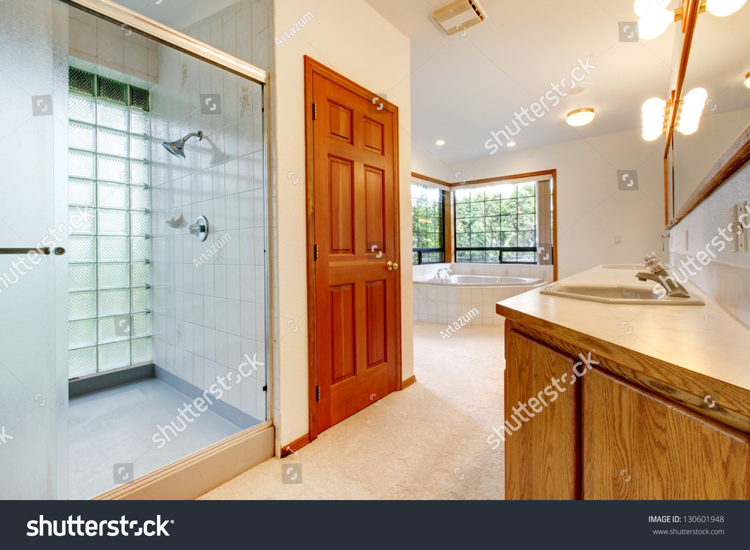 large white bathroom with tub shower shiny tiles and