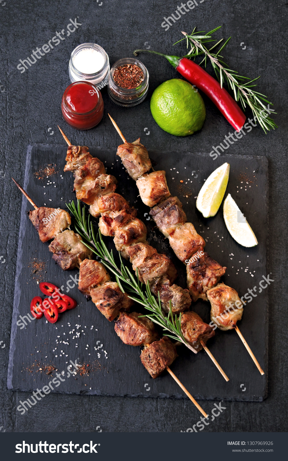 Fresh hot kebab with rosemary, lime and chili. Keto diet. Paleo diet. Pegan diet. #1307969926