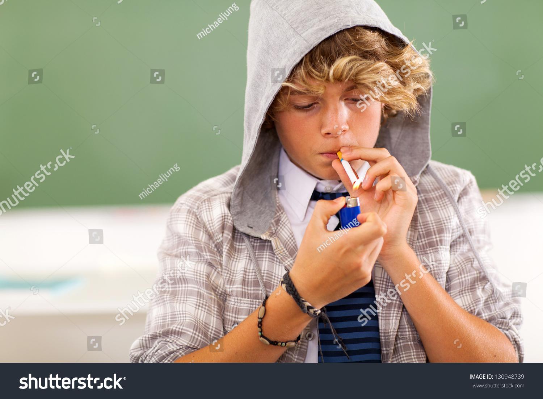 teenboy bad high school teen boy lighting cigarette in classroom