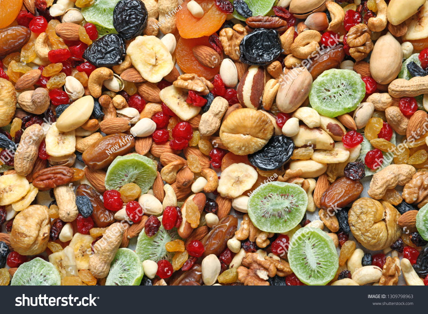 Different Dried Fruits Nuts Background Closeup Stock Photo