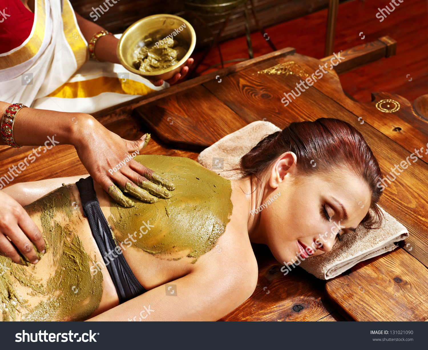 young woman having body ayurveda spa massage stock photo 131021090 shutterstock. Black Bedroom Furniture Sets. Home Design Ideas