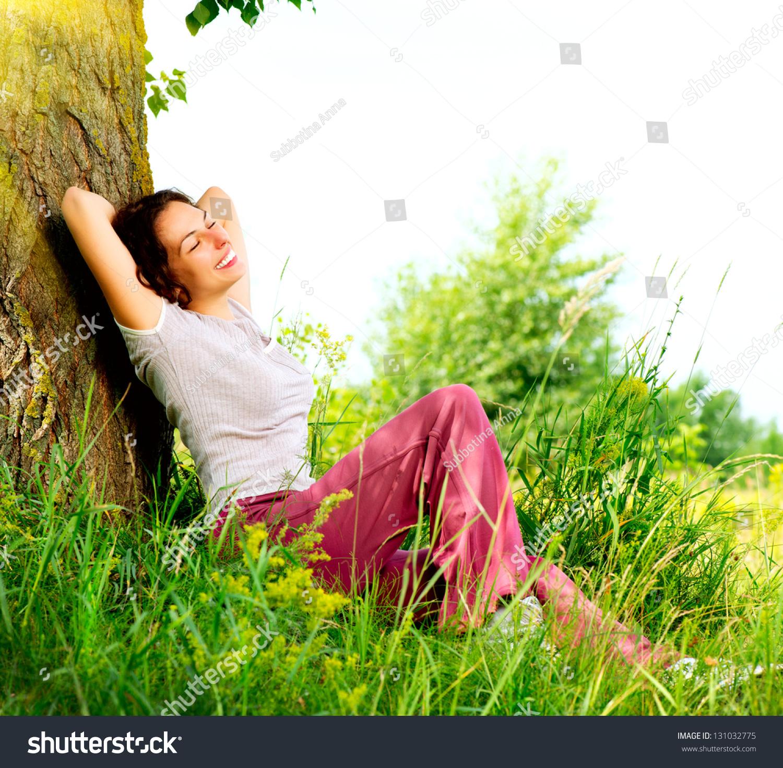Happy Beautiful Woman Enjoying At Beach Stock Photo: Beautiful Young Woman Relaxing Outdoors. Meadow. Beauty