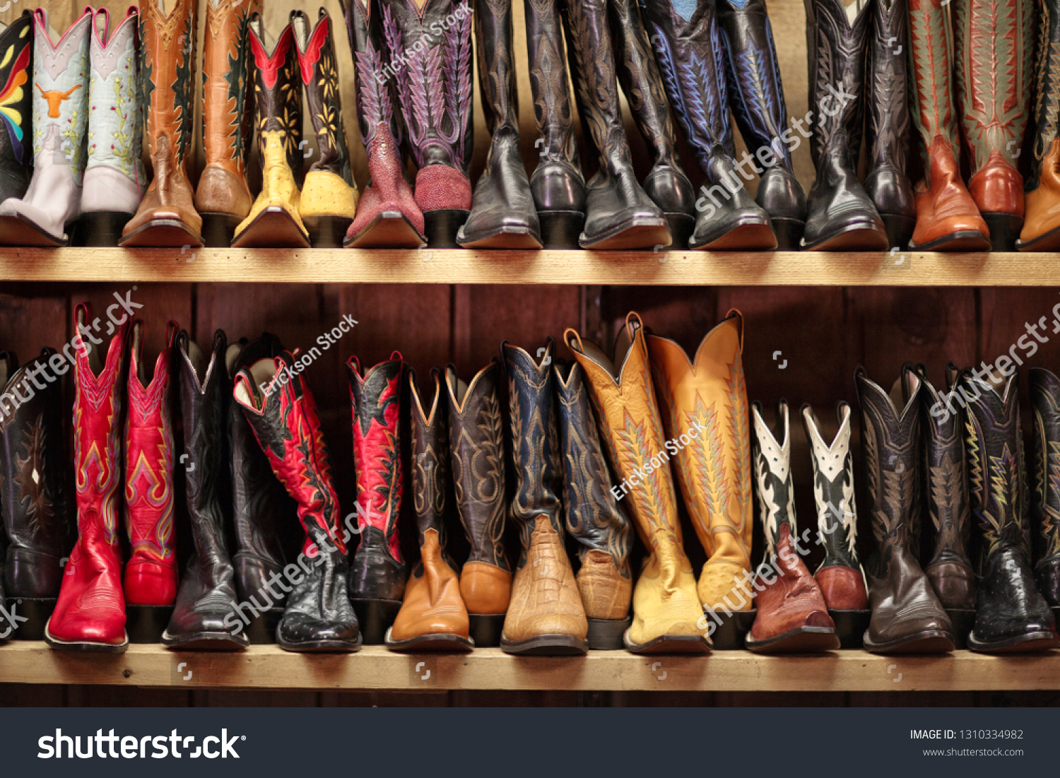 906abad2798 Rows Cowboy Boots Lined On Shelves Stock Photo (Edit Now) 1310334982