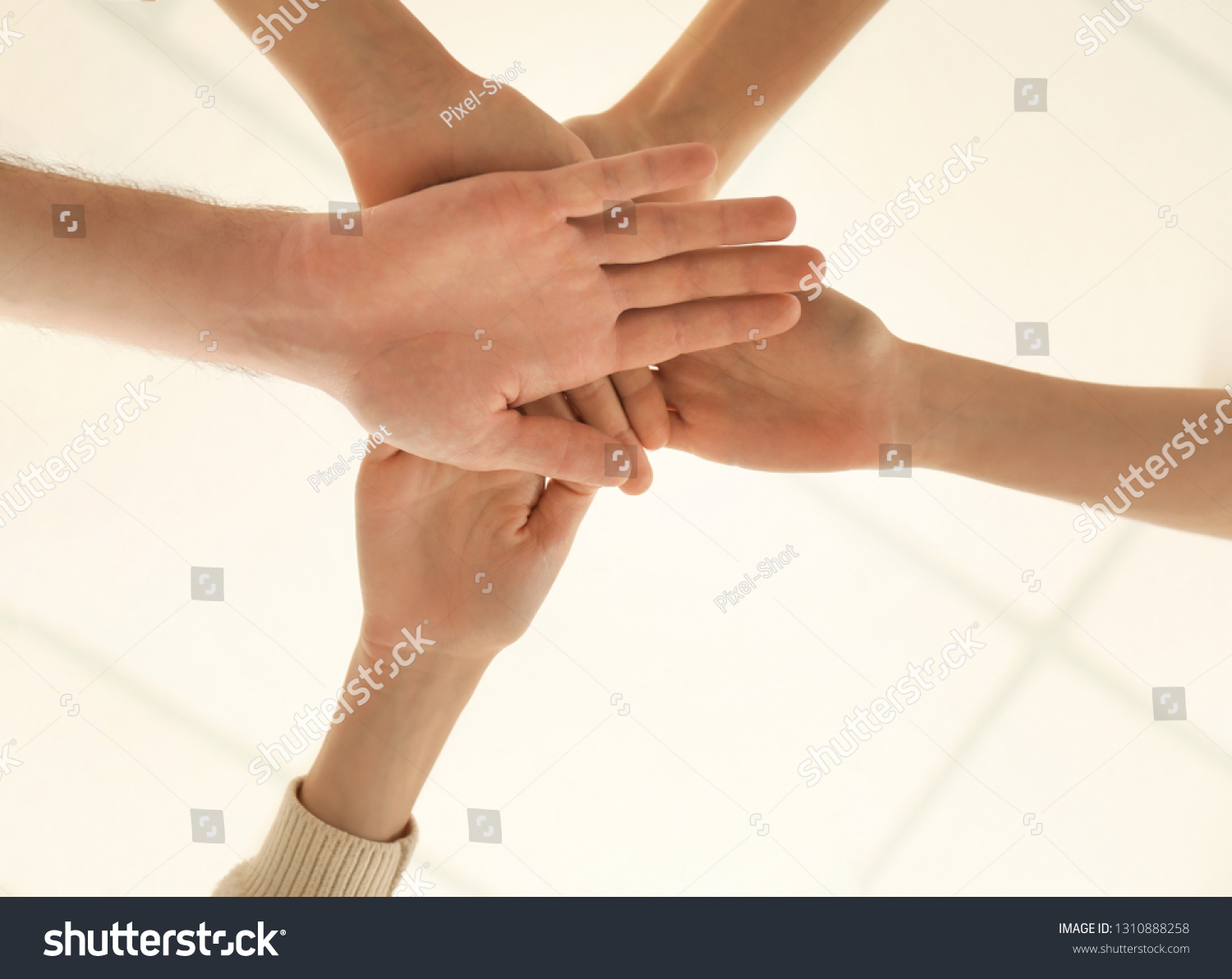People Putting Hands Together Symbol Unity Stock Photo Edit Now 1310888258